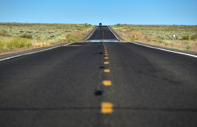 "A motorist travels along U.S. Highway 50 west of Eureka, Nev. Wednesday, July 13, 2016. Since a 1986 Life magazine which dubbed the Nevada portion of the road  ""The Loneliest Road in America,""  st ..."