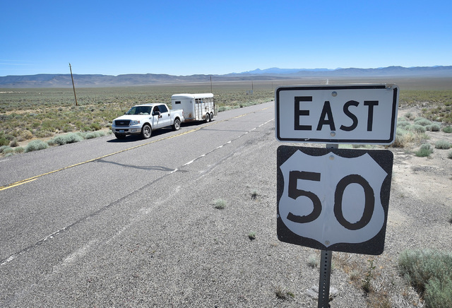 "A U.S. Highway 50 road sign is seen east of Austin, Nev. Wednesday, July 13, 2016. Since a 1986 Life magazine which dubbed the Nevada portion of the road ""The Loneliest Road in America,"" state tou ..."
