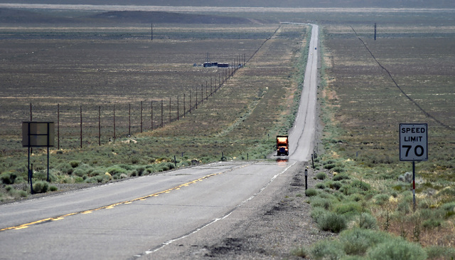 "A truck travels along the long and straight pavement of U.S. Highway 50, east of Austin, Nev. Wednesday, July 13, 2016. Since a 1986 Life magazine which dubbed the Nevada portion of the road ""The  ..."