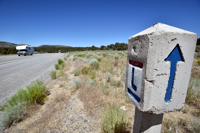 Tourists pass a Lincoln Highway marker east of Austin, Nev. Wednesday, July 13, 2016. The Lincoln Highway was one of the earliest transcontinental highways, and is now dubbed U.S. Highway 50 in Ne ...