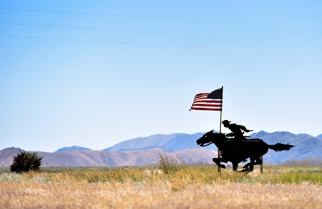 A silhouetted figure of a pony express rider attracts motorist along U.S. Highway 50 in Cold Springs, Nev. Wednesday, July 13, 2016. From 1860 to 1861, Pony Express riders galloped the along the r ...