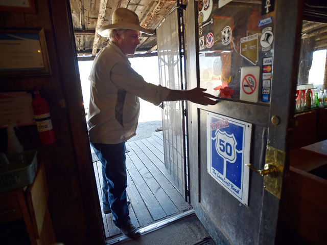 "Russ Stevenson heads into his restaurant and bar at the Middlegate Station Wednesday, July 13, 2016, in Middlegate, Nev. Since a 1986 Life magazine which dubbed the Nevada portion of the road ""The ..."