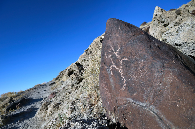 A Petroglyph is seen on a stone near the Hidden Cave at Grimes Point Wednesday, July 13, 2016, east of Fallon, Nev. The state of Nevada created a tourism program for motorists to visit and stop al ...
