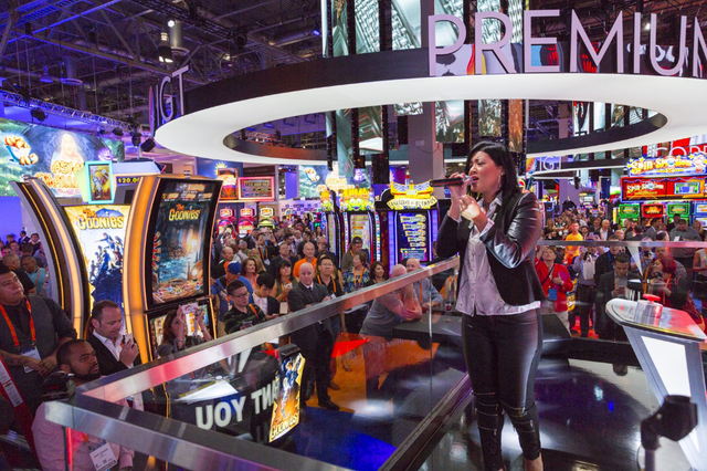 """The Voice"" winner Tessanne Chin sings at Global Gaming Expo to launch ""Voice"" slot. (IGT)"