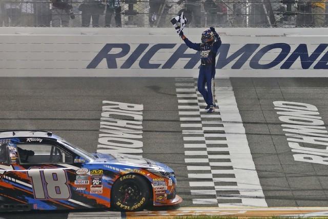 Kyle Busch celebrates his victory in the NASCAR Xfinity auto race at Richmond International Raceway in Richmond, Va., Friday, Sept. 9, 2016. (AP Photo/Steve Helber)