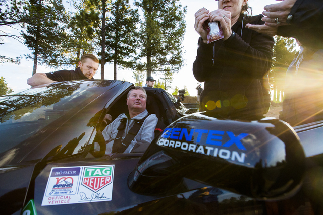 Sam Schmidt, middle, an ex IndyCar driver paralyzed in a January, 2000 crash, prepares to test his customized Corvette in preparation for the Pikes Peak Hill Climb on Friday, June 10, 2016, in Col ...