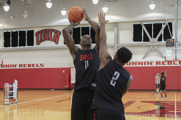 UNLV's Cheickna Dembele (11) shoots over Uche Ofoegbu (2) during team practice at the Mendenhall Center at UNLV in Las Vegas on Monday, Aug. 8, 2016. (Richard Brian/Las Vegas Review-Journal) Follo ...