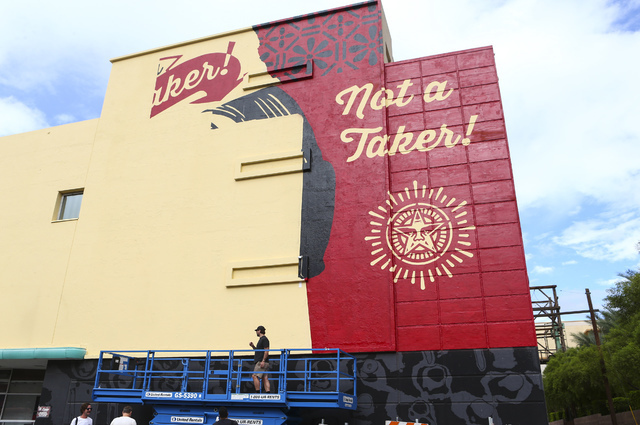Artist Shepard Fairey works on a mural as setup goes on for the Life is Beautiful music and arts festival in downtown Las Vegas on Wednesday, Sept. 21, 2016. Chase Stevens/Las Vegas Review-Journal ...