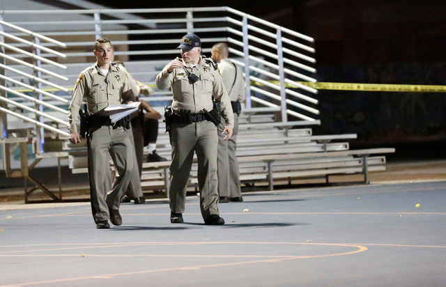 Police officers investigate around Palacio Park in Las Vegas, Thursday, Sept. 1, 2016 after a shooting. (Chitose Suzuki/Las Vegas Review-Journal)