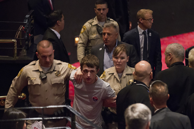 Michael Steven Sandford is escorted out of a campaign rally for Republican presidential candidate Donald Trump at the Treasure Island hotel-casino on Saturday, June 18, 2016, in Las Vegas. (Erik V ...