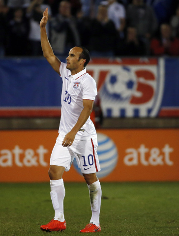 United State's Landon Donovan waves to the crowd as he comes out of an exhibition soccer match against Ecuador in East Hartford, Conn., Friday, Oct. 10, 2014. Donovan is making his last internatio ...