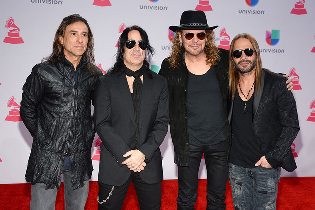 Juan Calleros, from left, Alex Gonzalez, Fher Olvera, and Sergio Vallin, of Mana, arrive at the 16th annual Latin Grammy Awards at the MGM Grand Garden Arena on Thursday, Nov. 19, 2015, in Las Veg ...