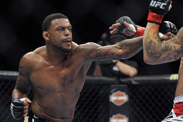 Michael Johnson Gleison Tibau during their UFC 168 mixed martial arts lightweight fight on Saturday, Dec. 28, 2013, in Las Vegas.  (David Becker/AP)