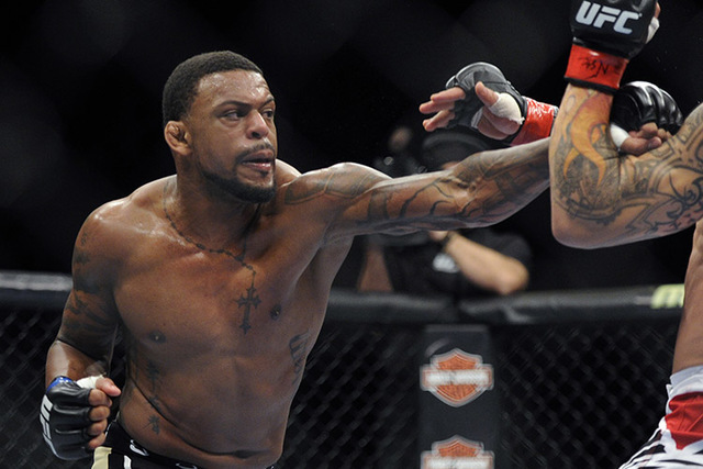 Michael Johnson  during UFC 168.  (David Becker/Associated Press)