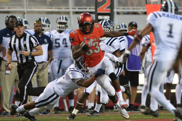 UNLV Rebels wide receiver Devonte Boyd (83) breaks a tackle for a 56-yard touchdown pass against Jackson State in the first quarter during the UNLV Jackson State football game in Las Vegas on Thur ...