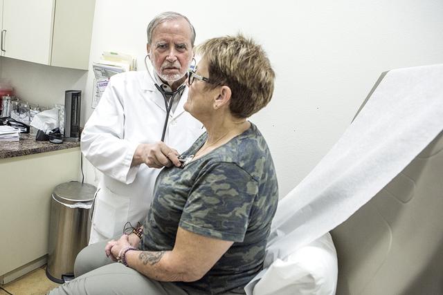 Dr. James Gabroy listens to patient Patricia McCarley's heart on Wednesday, Aug. 31, 2016.  (Jeff Scheid/Las Vegas Review-Journal Follow @jeffscheid)