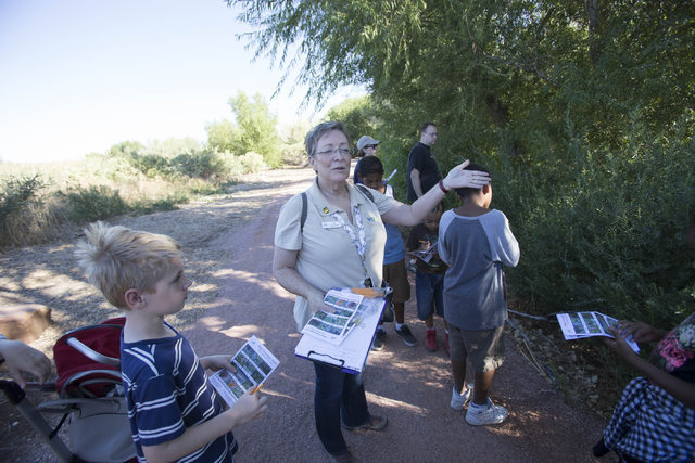 Jan Steinbaugh, program assistant at the Clark County Wetlands Park, shares tips of information with youngsters  on a nature walk at the park on Saturday, Sept. 24, 2016. Richard Brian/Las Vegas R ...