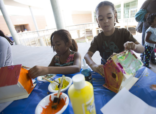 Las Vegas residents Pashyn Smith, 10, and her brother Carmelloh Martinez, 5, add paint to birdhouses they built during a science workshop at the Wetlands Park on Saturday, Sept. 24, 2016. Richard  ...