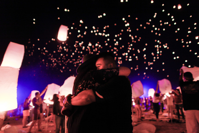 John Aboyo, right, and Denise Serrano embrace one another as lanterns are released into the sky at Rise Lantern Festival at the Moapa River Indian Reservation on Saturday, Oct. 10, 2015. Chase Ste ...