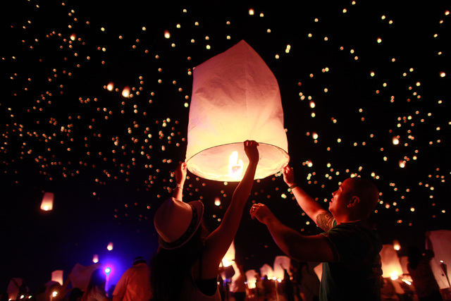 Myra, left, and Mark Hatten prepare to release a lantern into the sky at Rise Lantern Festival at the Moapa River Indian Reservation on Saturday, Oct. 10, 2015. Chase Stevens/Las Vegas Review-Jour ...