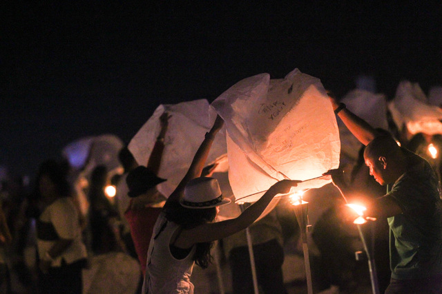 Mark Hatten, right, and Myra Hatten prepare to release their lantern at Rise Lantern Festival at the Moapa River Indian Reservation on Saturday, Oct. 10, 2015. Chase Stevens/Las Vegas Review-Journ ...