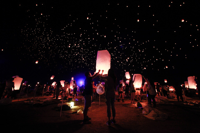 Lanterns are released into the sky at Rise Lantern Festival at the Moapa River Indian Reservation on Saturday, Oct. 10, 2015. Chase Stevens/Las Vegas Review-Journal Follow @csstevensphoto