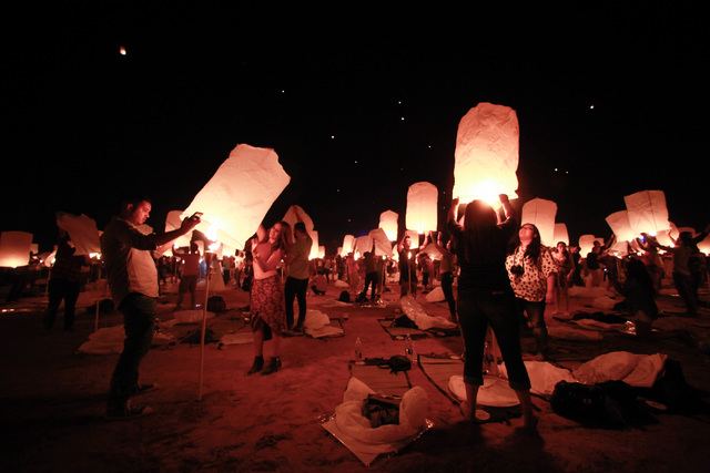 Attendees prepare to release their lanterns at Rise Lantern Festival at the Moapa River Indian Reservation on Saturday, Oct. 10, 2015. Chase Stevens/Las Vegas Review-Journal Follow @csstevensphoto