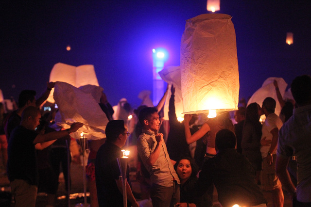 Attendees dodge a lantern flying through the crowd at Rise Lantern Festival at the Moapa River Indian Reservation on Saturday, Oct. 10, 2015. Chase Stevens/Las Vegas Review-Journal Follow @cssteve ...