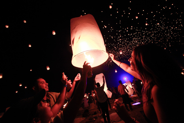 Heather Jamal, right, and Josh Beattie, second from left, prepare to release a lantern into the sky at Rise Lantern Festival at the Moapa River Indian Reservation on Saturday, Oct. 10, 2015. Chase ...