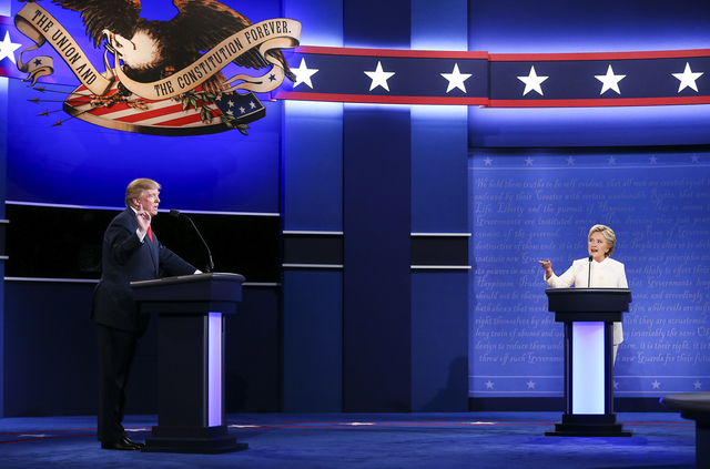 Republican candidate Donald Trump, left, and Democratic candidate Hillary Clinton speak during the third presidential debate at the Thomas & Mack Center at UNLV in Las Vegas on Wednesday, Oct. ...