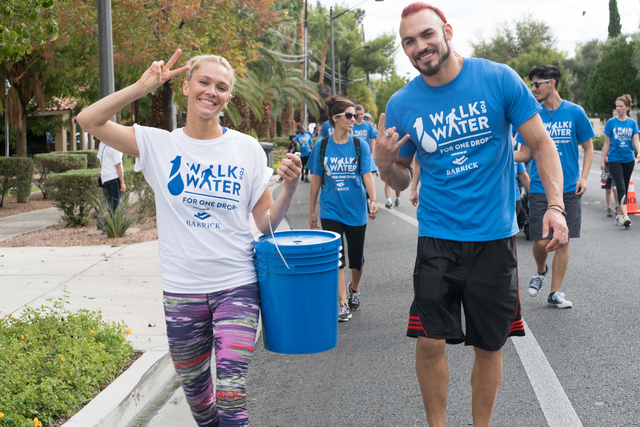 "Brandon Pereyda, right, of Cirque du Soleil's ""Zumanity"" at New York-New York takes part in One Drop Walk for Water on Saturday, Oct. 17, 2015, in Las Vegas. (Cashman Photo)"