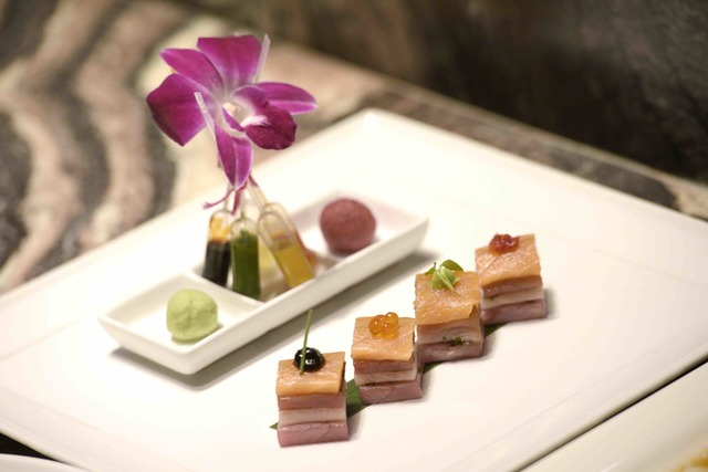The Morimoto Sashimi featuring seared toro, salmon, eel, tuna, hamachi and fice sauces is seen during the grand opening of Masaharu Morimoto's first Las Vegas restaurant, Morimoto, at MGM Grand on ...