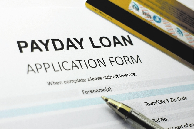 A payday short immediate loan application form is seen. View file photo