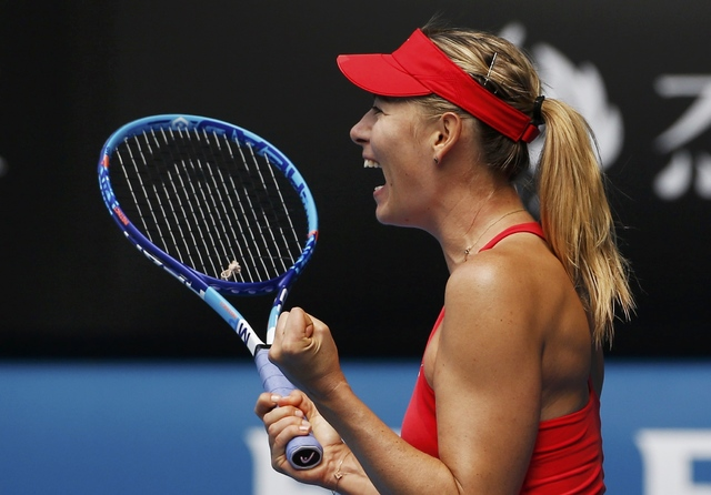 Maria Sharapova of Russia celebrates after defeating compatriot Ekaterina Makarova in their women's singles semi-final match at the Australian Open 2015 tennis tournament in Melbourne January 29,  ...