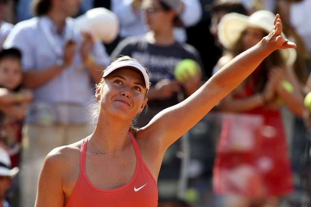 Maria Sharapova of Russia celebrates winning against Carla Suarez Navarro of Spain after their final match at the Rome Open tennis tournament in Rome, Italy, May 17, 2015. (Stefano Rellandini/Reuters)