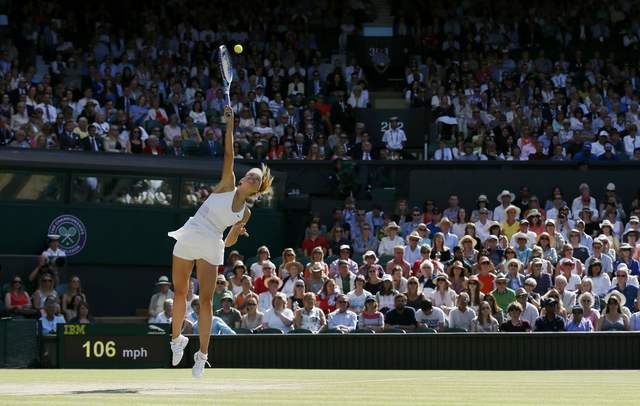 Maria Sharapova of Russia serves during her match against Serena Williams of the U.S.A. at the Wimbledon Tennis Championships in London, July 9, 2015. (Stefan Wermuth/Reuters)