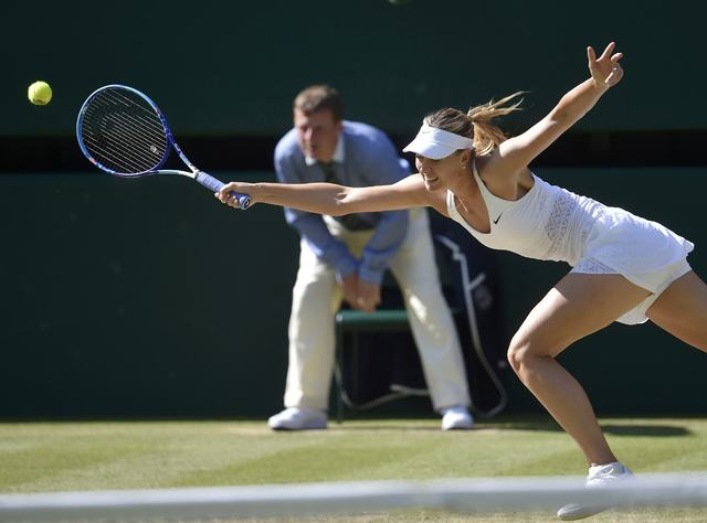 Maria Sharapova of Russia stretches for a shot during her match against Serena Williams of the U.S.A. at the Wimbledon Tennis Championships in London, July 9, 2015. (Toby Melville/Reuters)