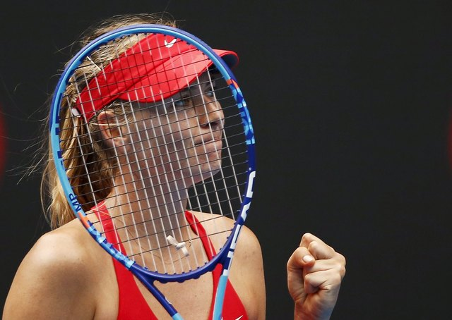 Maria Sharapova of Russia celebrates defeating Alexandra Panova to win their women's singles second round match at the Australian Open 2015 tennis tournament in Melbourne in this January 21, 2015  ...