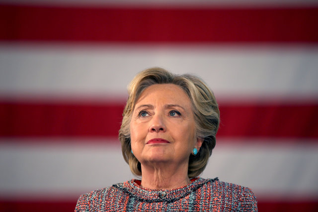 U.S. Democratic presidential nominee Hillary Clinton listens to former Vice President Al Gore talk about climate change at a rally at Miami Dade College in Miami, Florida, U.S. October 11, 2016. ( ...