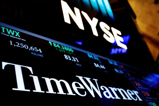 Ticker and trading information for media conglomerate Time Warner Inc. is displayed at the post where it is traded on the floor of the New York Stock Exchange (NYSE) in New York City, U.S., Octobe ...