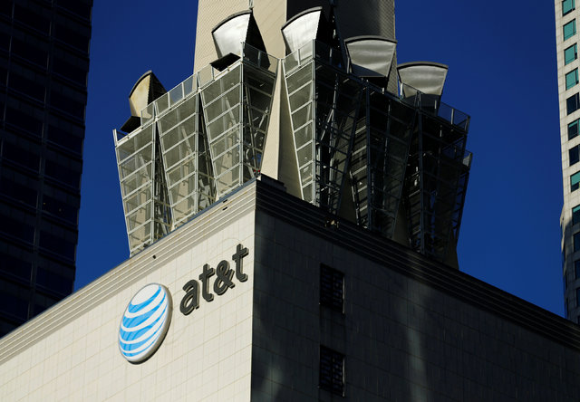 An AT&T logo and communication equipment is shown on a building in downtown Los Angeles, California October 29, 2014. (Brendan McDermid/Reuters)