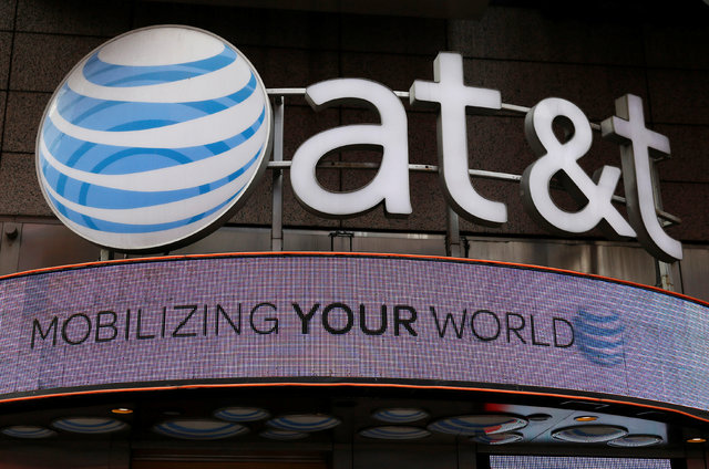 Signage for an AT&T store is seen in New York October 29, 2014. (Shannon Stapleton/Reuters)