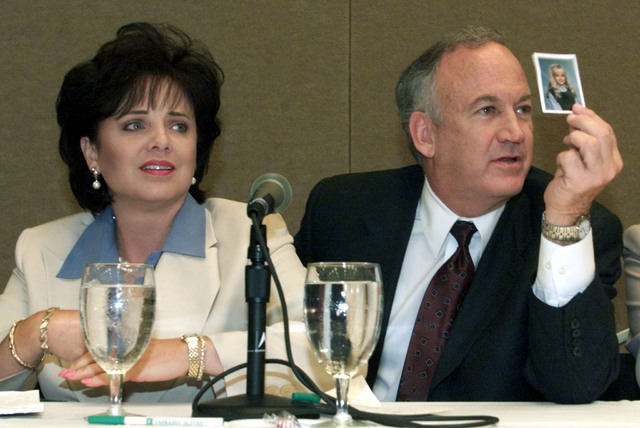 Patsy Ramsey and her husband, John Ramsey, produce a picture of JonBenet Ramsey during a press conference in Atlanta where they released the results of an independent lie detector test on May 24,  ...