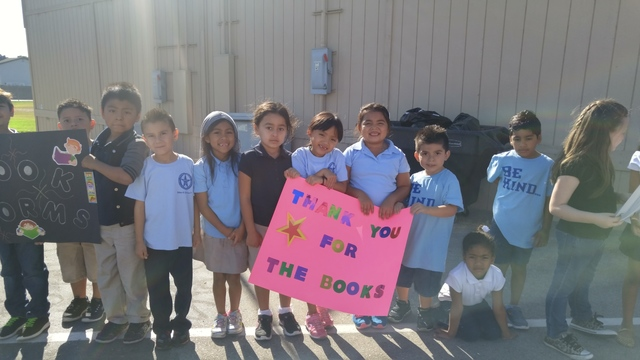 Gene Ward Elementary School first graders wait for the Ride for Reading bicyclists to arrive Sept. 22, 2016, with the 2,500 books that are being donated to the school. Each student will be able to ...
