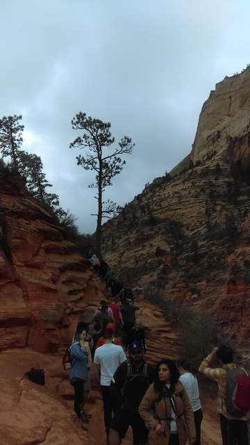 Hikers wait their turn to climb to the top of Angels Landing at Zion National Park on March 12. Since 2010, the park in Utah, 160 miles northeast of Las Vegas, has seen its annual visitation incre ...