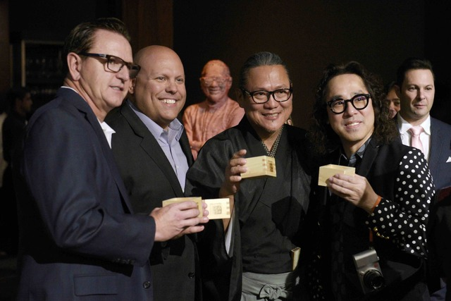 MGM Grand President and COO Scott Sibella, MGM Grand Vice President of Food and Beverage Jason Shkorupa, Masaharu Morimoto and interior designer Yasumichi Morita stand for a photo during the grand ...