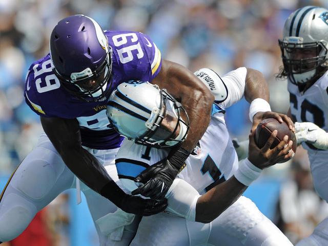 Carolina Panthers' Cam Newton (1) is sacked in the end zone for a safety by Minnesota Vikings' Danielle Hunter (99) in the first half of an NFL football game in Charlotte, N.C., Sunday, Sept. 25,  ...