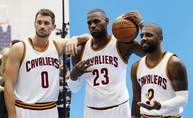 Cleveland Cavaliers forward Kevin Love (0), LeBron James (23) and Kyrie Irving (2) pose for photographs during the NBA basketball team's media day, Monday, Sept. 26, 2016, in Independence, Ohio. ( ...