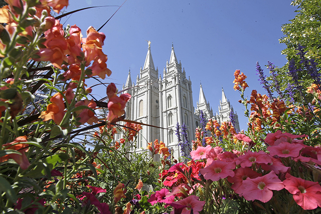 Flowers bloom in front of the Salt Lake Temple, at Temple Square, in Salt Lake City. (Rick Bowmer/AP)