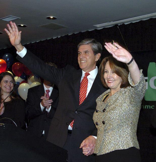 In this Nov. 4, 2008, file photo, Sen. Gordon Smith, R-Ore., with his wife, Sharon, waves to supporters after announcing that his race against Jeff Merkely is too close to call in Portland, Oregom ...